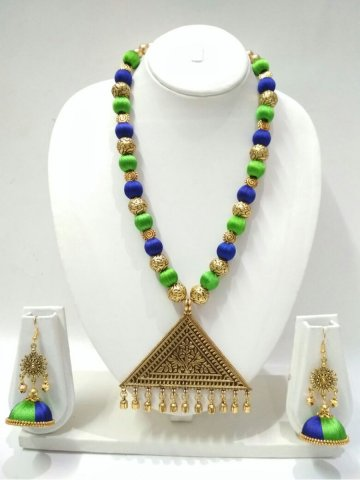 https://static2.cilory.com/296290-thickbox_default/ruby-hand-crafted-silk-thread-necklace-set.jpg
